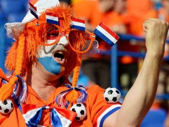 A Dutch soccer fan screams