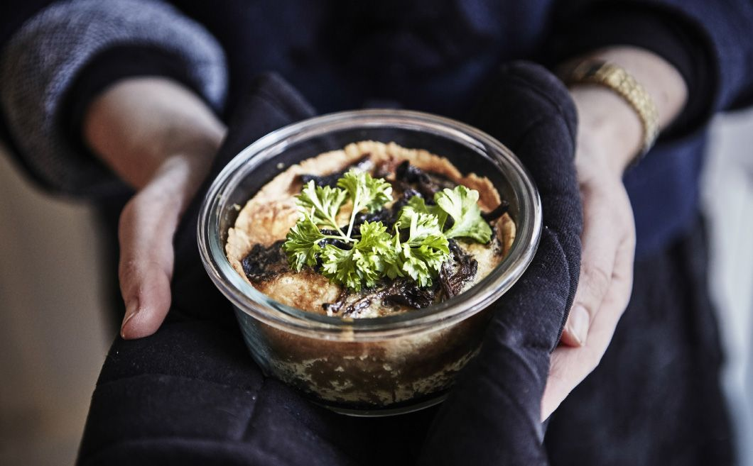 For serious decadence, layer sliced cooked potatoes, your favourite grated, sharp cheese, spinach and mushrooms in a small casserole dish. Let it bake until it's bubbly and brown on top.