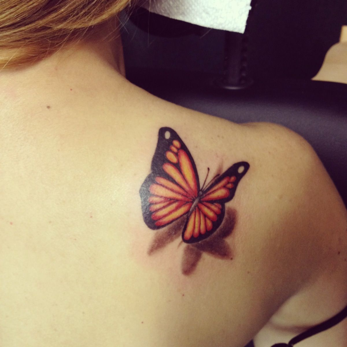 "The tattoo I want in memory of Kaylie.. With a colorful butterfly instead & with her name on the butterfly. Also with the words ""I will carry you with me"" around it."