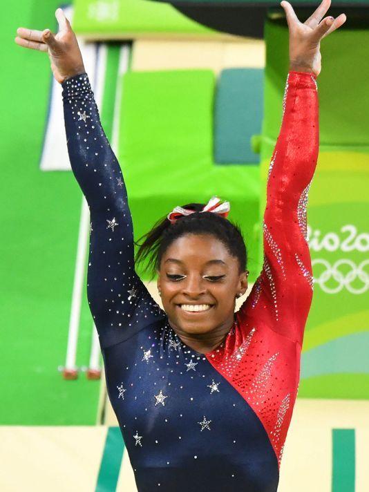 Behind Simone Biles, U.S. women romp in Olympic gymnastics team qualifying