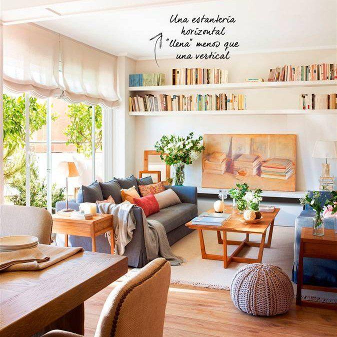 Salón comedor con sofás enfrentados grises, mesa de centro ...