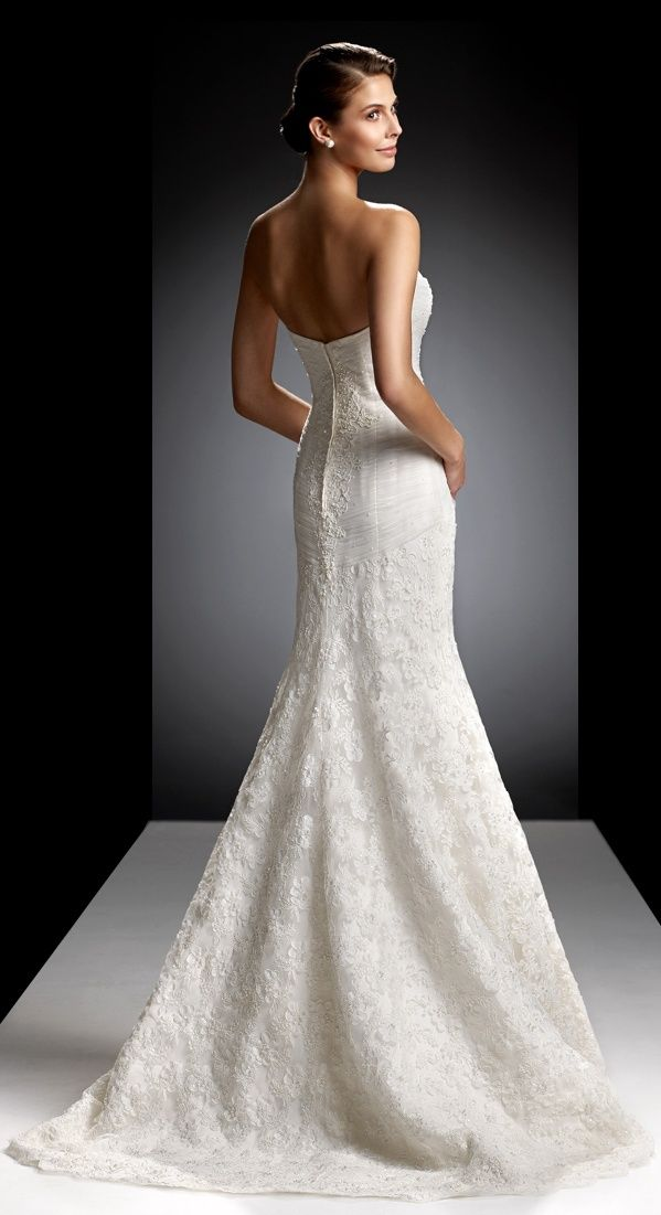 Backless is beautiful and the House of Oleg Cassini does it ...