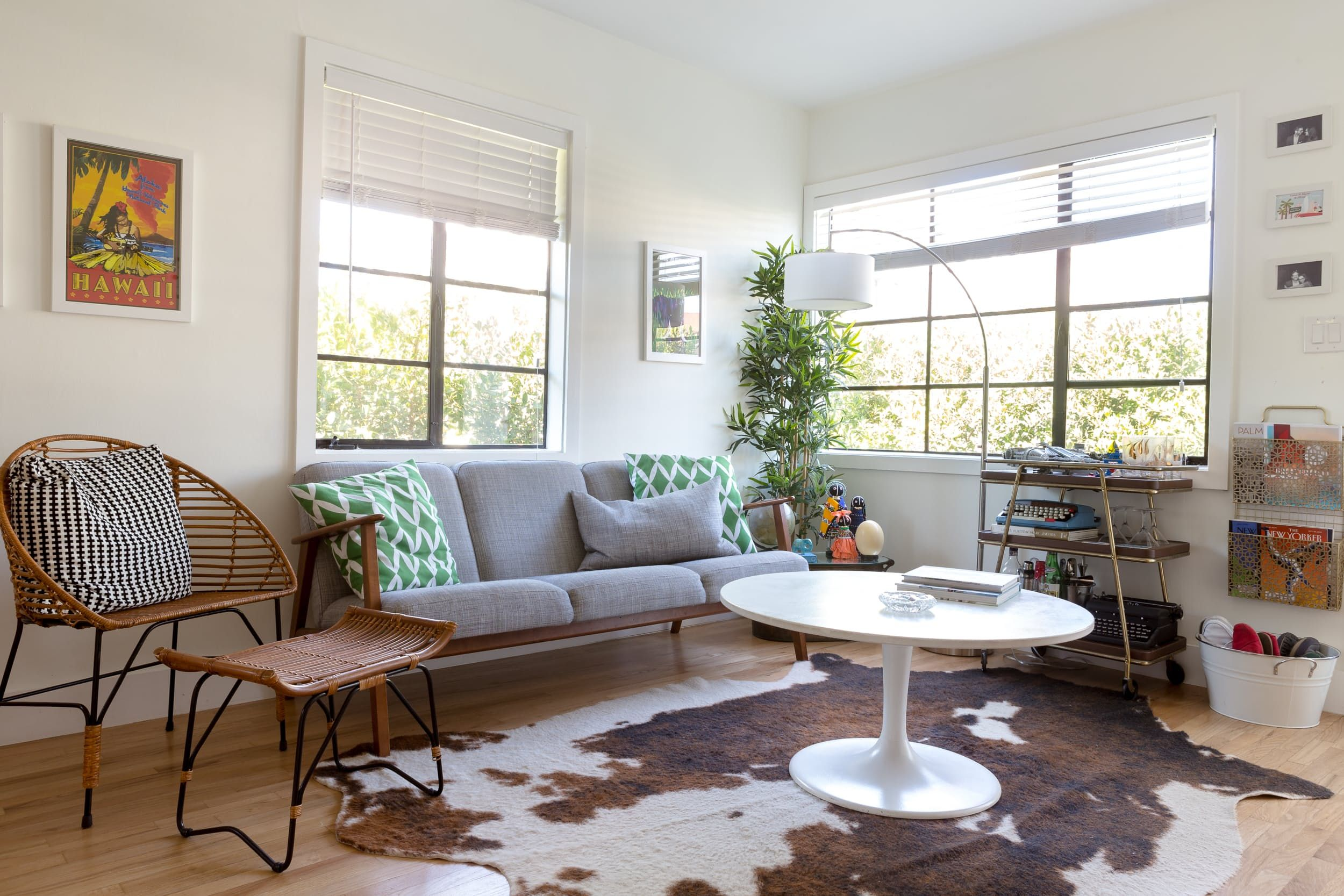 Marni says they've been slowly transforming their retro style into retro-meets-Hemingway. The sofa was found at IKEA and the side chair and ottoman set was found at Target. The vintage travel posters are from Etsy.