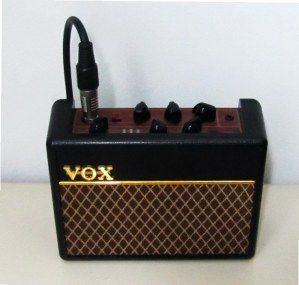 Ultra portable Vox AC-1 RhythmVOX - 1 watt guitar amp with nice creamy overdrive tone and handy drum machine. The weight of this baby is just about 0.5 kg allowing to take it anywhere