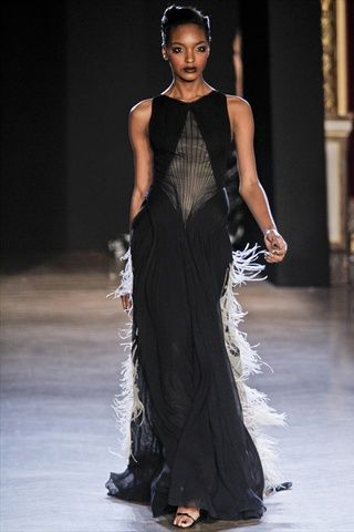 a ruffling of white feathers illuminate the back of this reinvented LBD