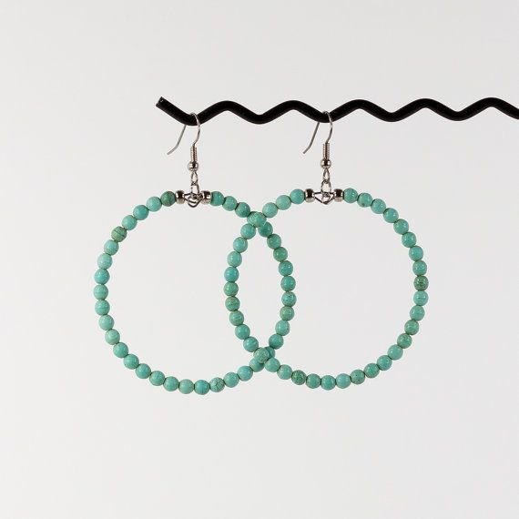 Gorgeous lightweight large hoop earrings created with beautiful earthy turquoise colored beads, finished with silver glass bead accents at the top. Hanging from surgical steel french wire hooks, approx. 3 in. long - hoops alone are 2 inches long.  These earrings look so gorgeous in person! Especially when worn with a ponytail or updo to really show them off. They are also very lightweight and so comfortable to wear.