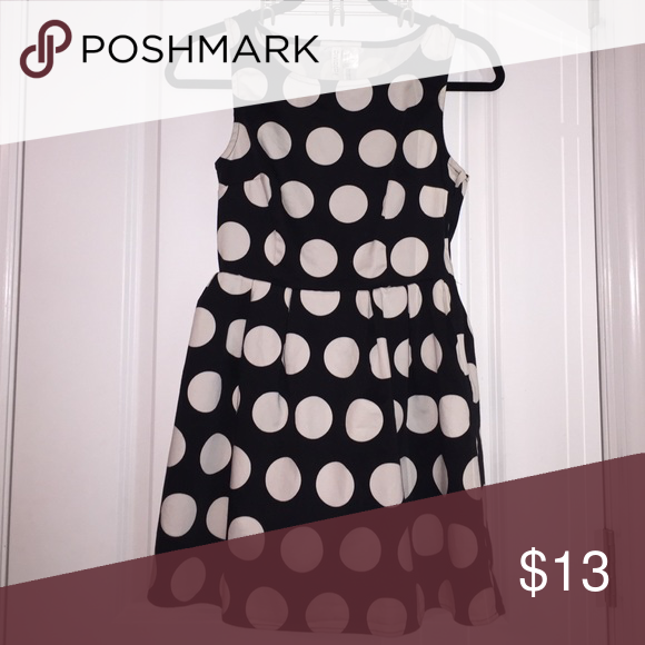 Black and White Polka Dot Dress H & M brand DIVIDED XS dress. Not stretchy material, has a zipper on the side. Says size 6 on tag but definitely fits like an XS!! Divided Dresses