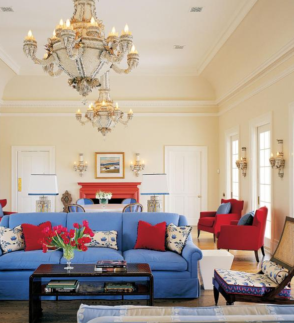 Blue Sofa With Red Chairs And Accent Pillows