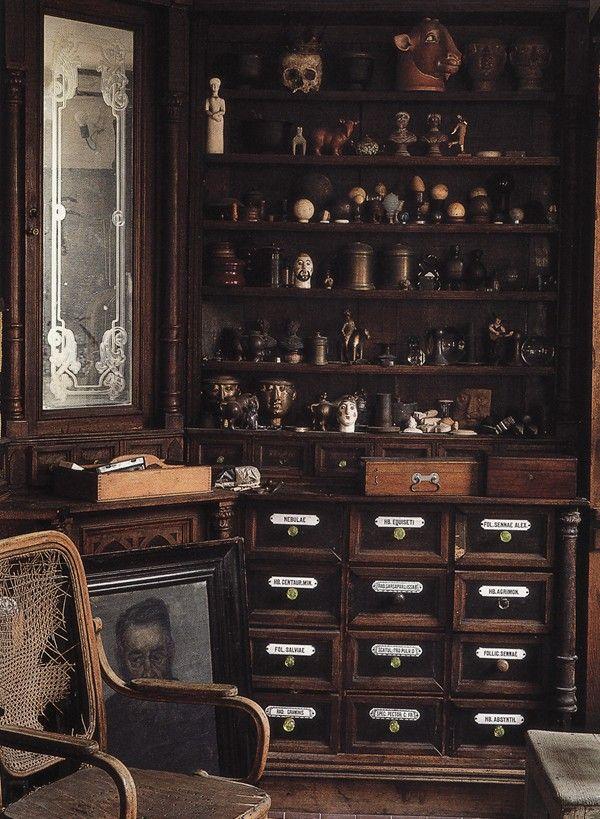 Chintz Hanging, dark cabinets, bottles, draws