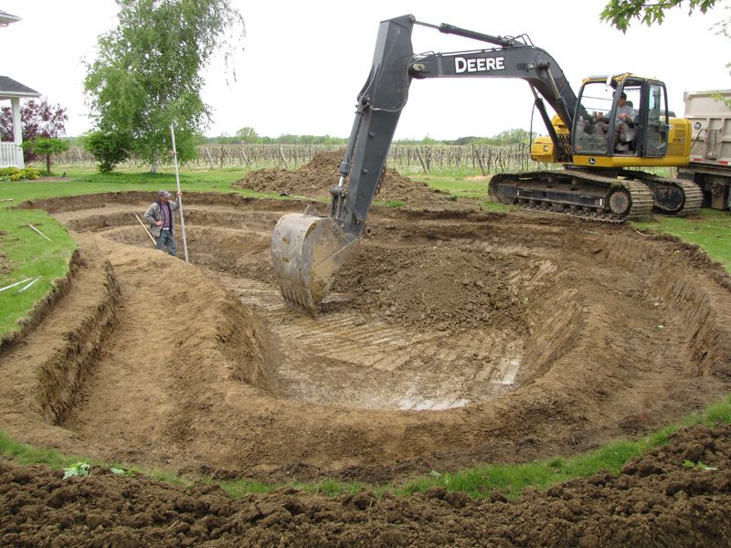 Natural spring pond design and construction of a for Garden pond design and construction
