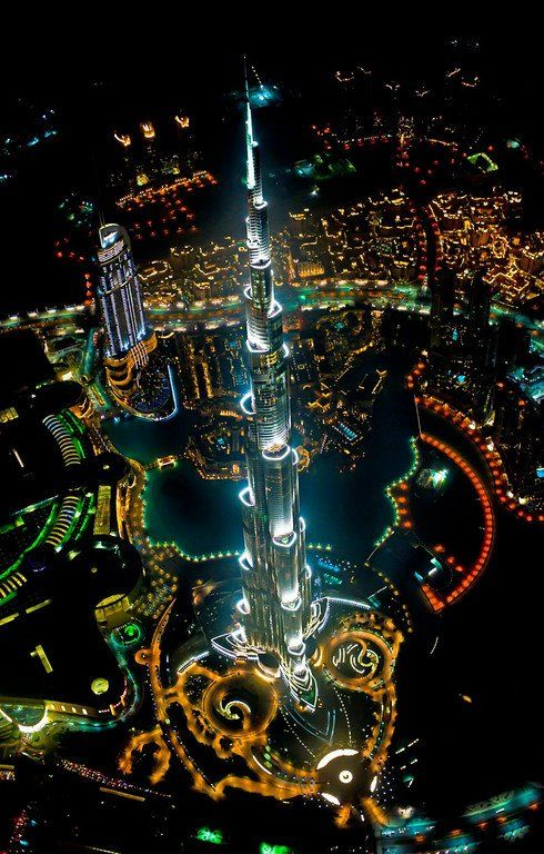 An incredible view of the Burj Khalifa, Downtown Dubai, at night. - Photographer Russ Kientsch shot this from a height of 1000m, hanging out the open door of a helicopter on a harness. So so pretty, eh?!? - photo @ http://russkientsch.viewbook.com/album/architectureandinteriors?p=1#1