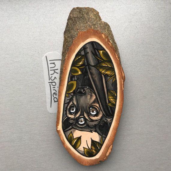 Wood slice with an original drawing of a bat door Inkspirednl