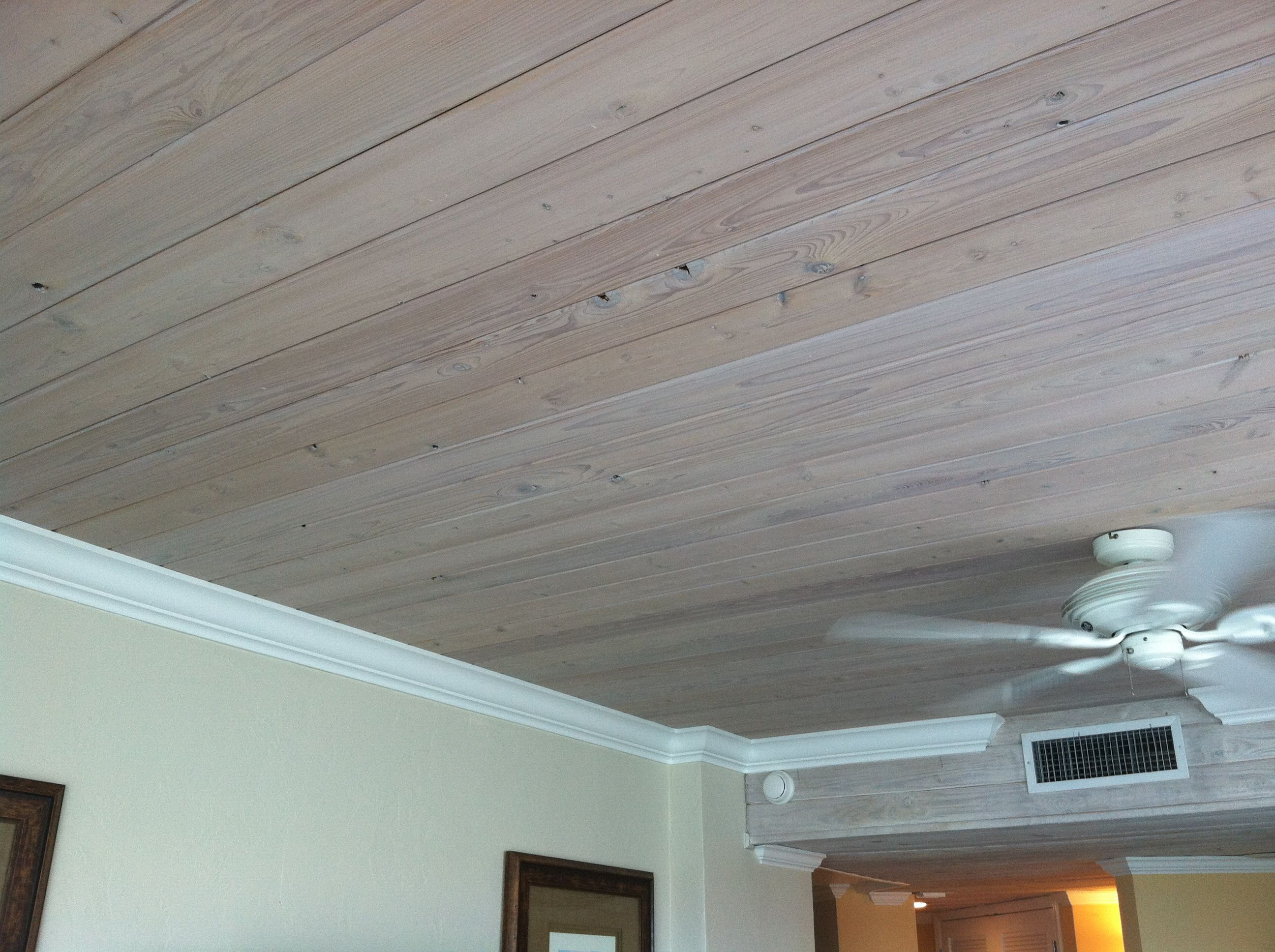 Wood ceiling and white crown molding.