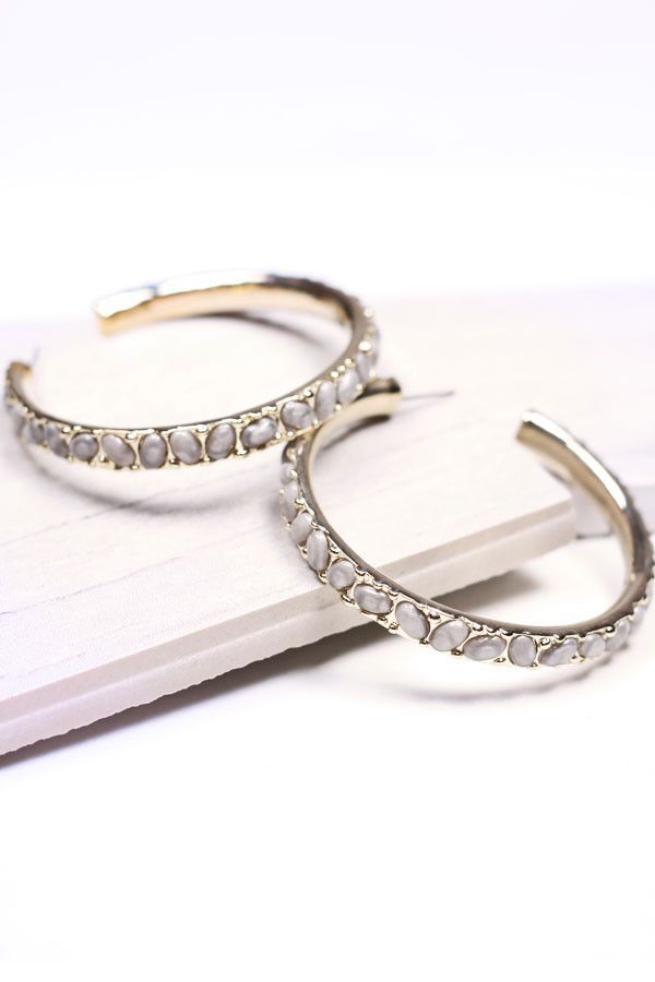 Designer inspired large gold tone hoop earrings with grey stone inlay.