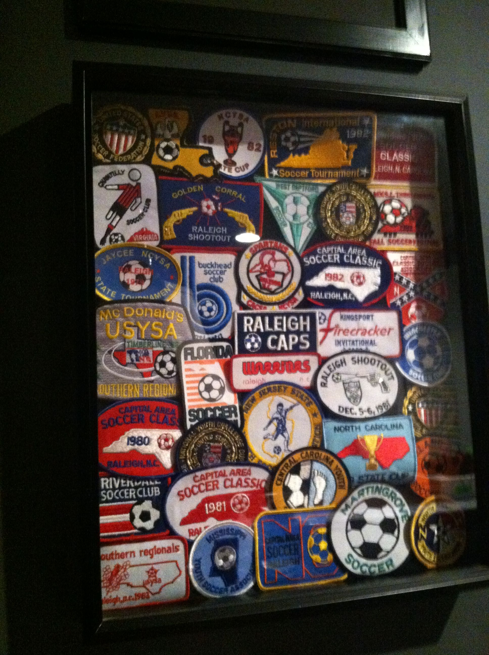 68c4b766018 Wonder what to do with all those old soccer patches  Make a collage of your  favorite ones and frame them for all to see.