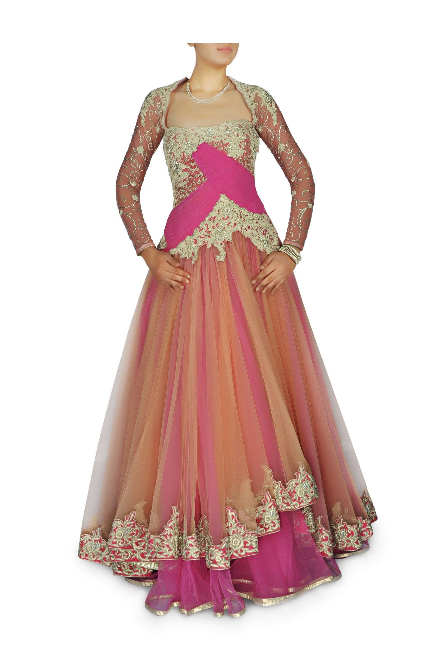 f0c4204df9b9 Featuring a Beige orange and Rani pink layered net gown. Zari work and  rhinestones and pleated pink net panels accentuate the upper half.