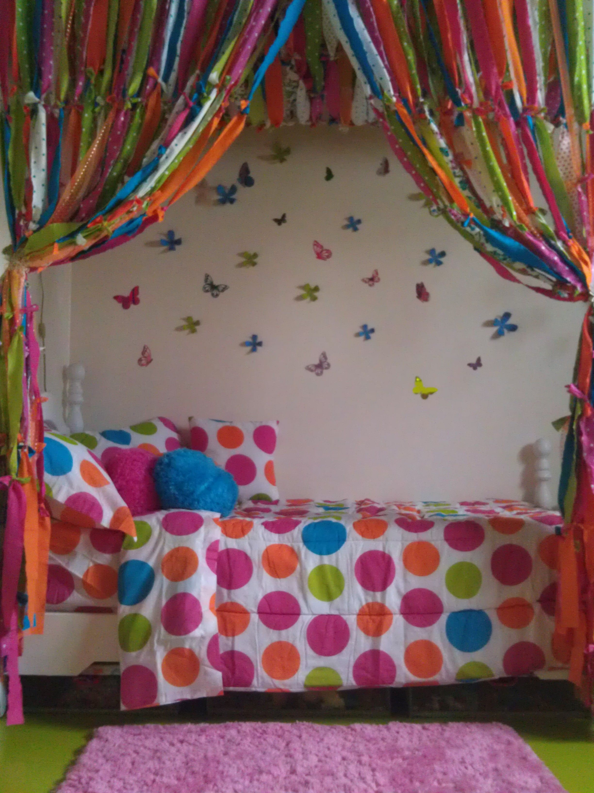 Nessa's room :) i love the way the curtains slope across the ceiling..