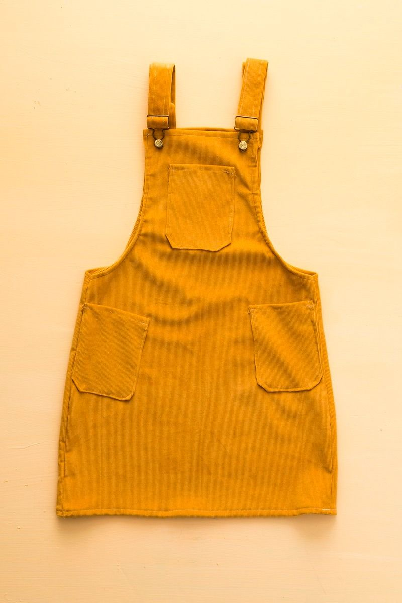 6cde8e21b7 Jump into spring with this easy yellow DIY overall dress style tutorial.