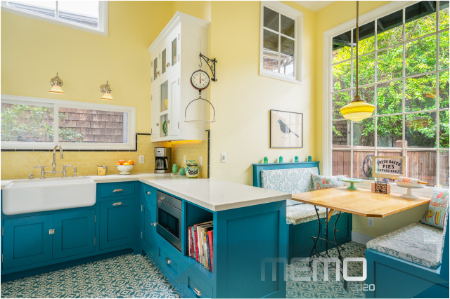 Feb 13 2020 Yellow And Blue Kitchen Mixes Modern Amenities With Vintage Charm Kitchenide Blue Kitchen Decor Yellow Kitchen Cabinets Farmhouse Kitchen Island