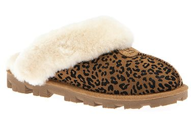 68d179b16c7 Slip on the comfy UGG Coquette Rosette slipper in Chestnut with a ...