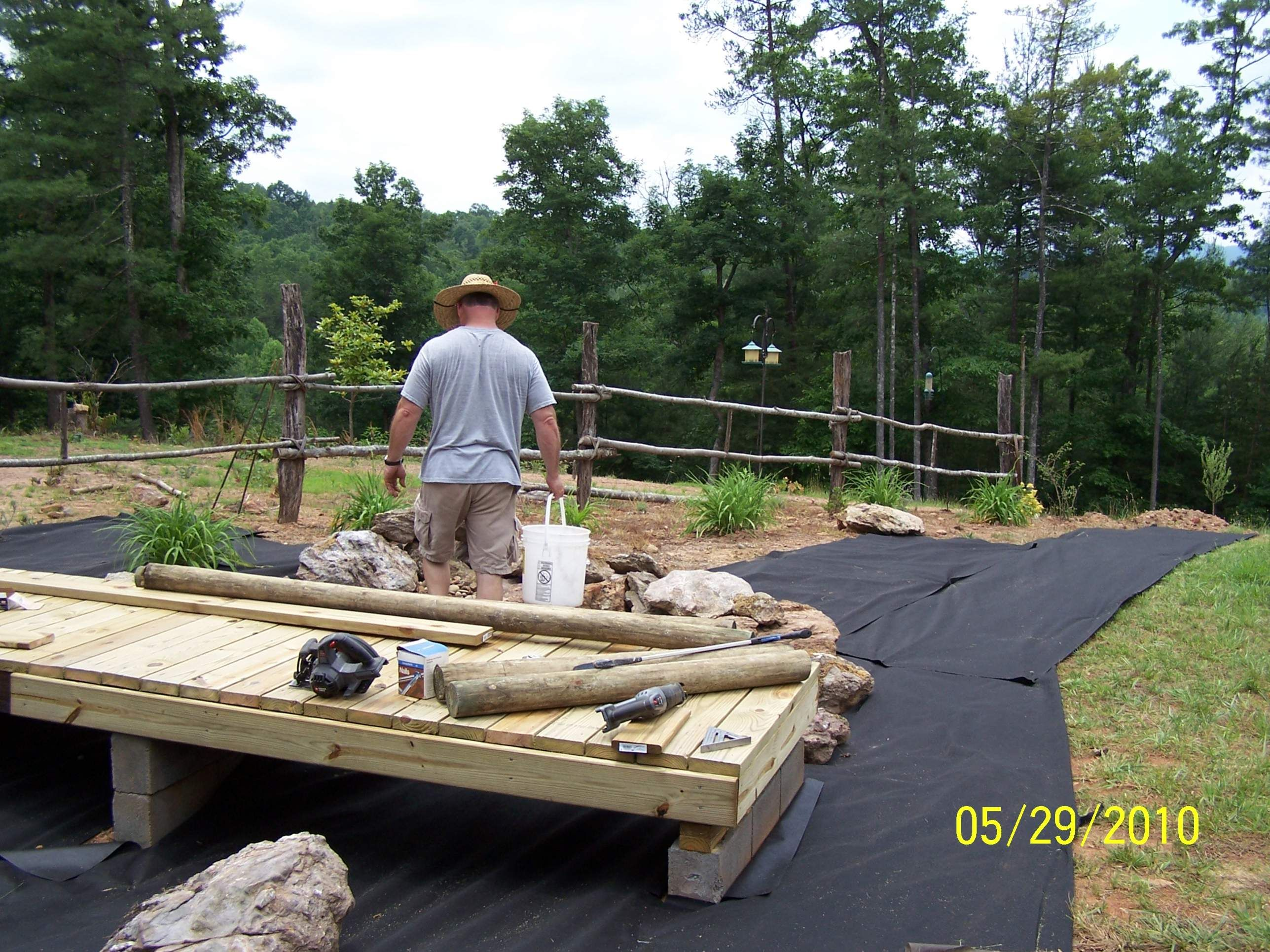 Dry creek bed with bridge and fabric. Dry creek bed