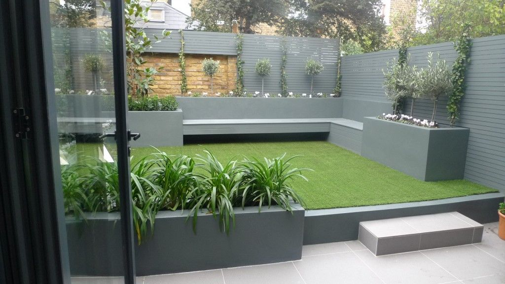 modern small low maintenance garden fake grass grey raised beds contemporary planting
