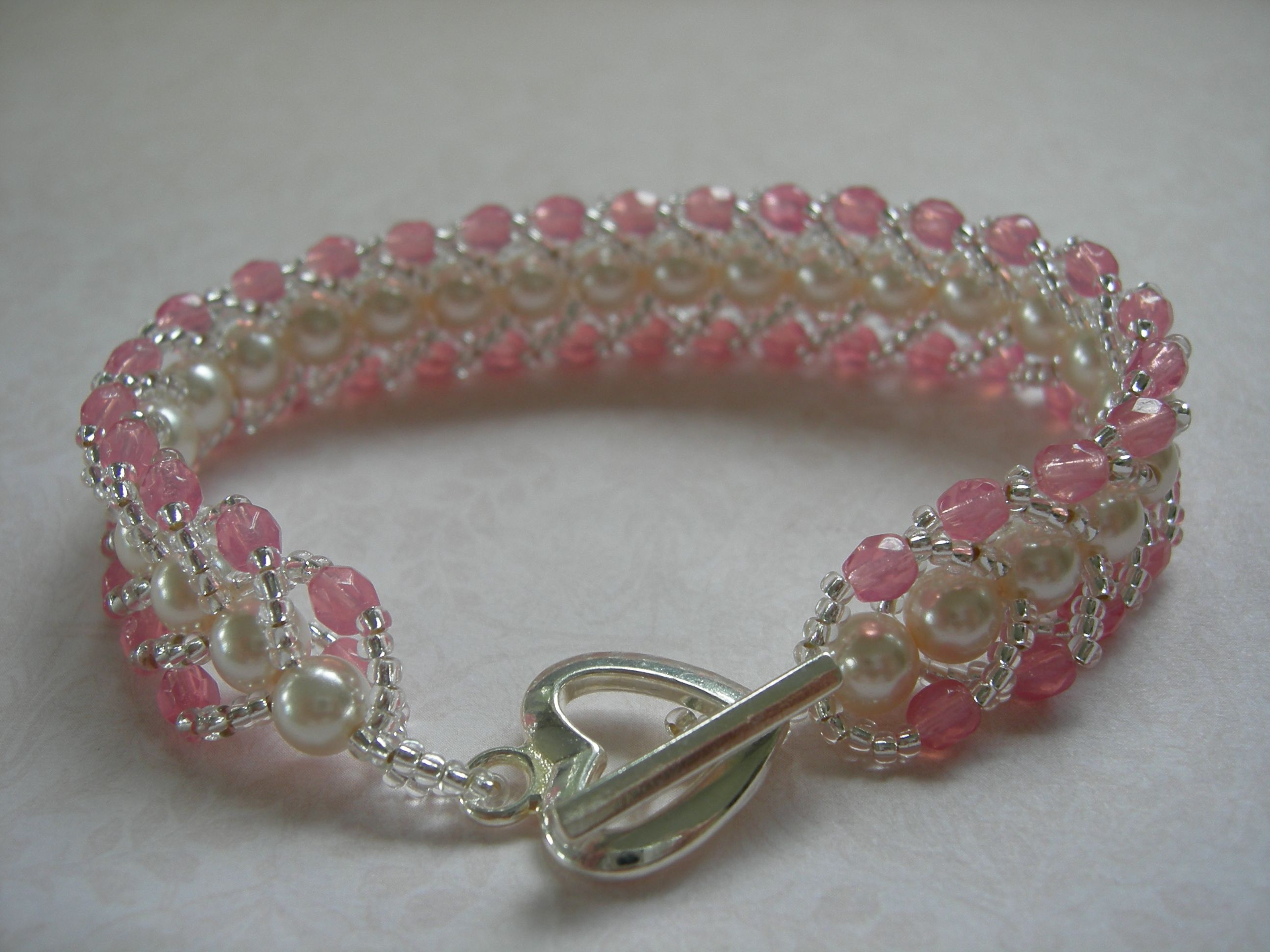 Pink czech glass and glass pearl flat spiral bracelet  $25