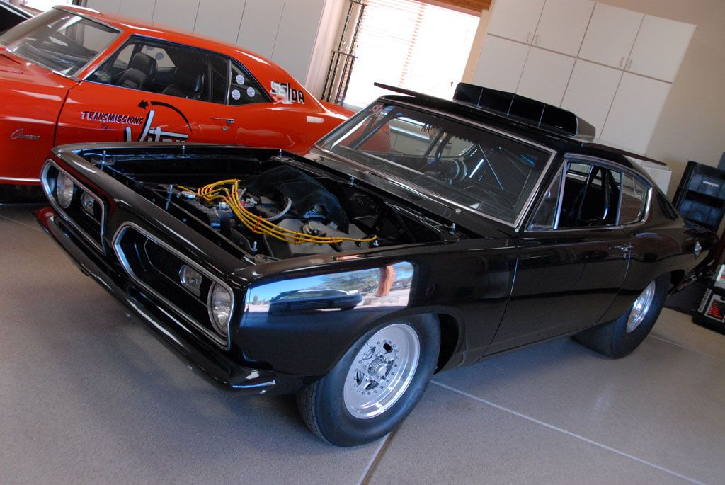 Auto Trader Classics - This black Hemi Cuda with a lift-off hood is ...