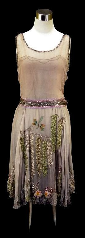 Darling 1920's beaded party dress. The neckline on this is darling. I also like the pictorial beading/applique, that doesn't follow the lines of the dress. It's an interesting way to move the eye.