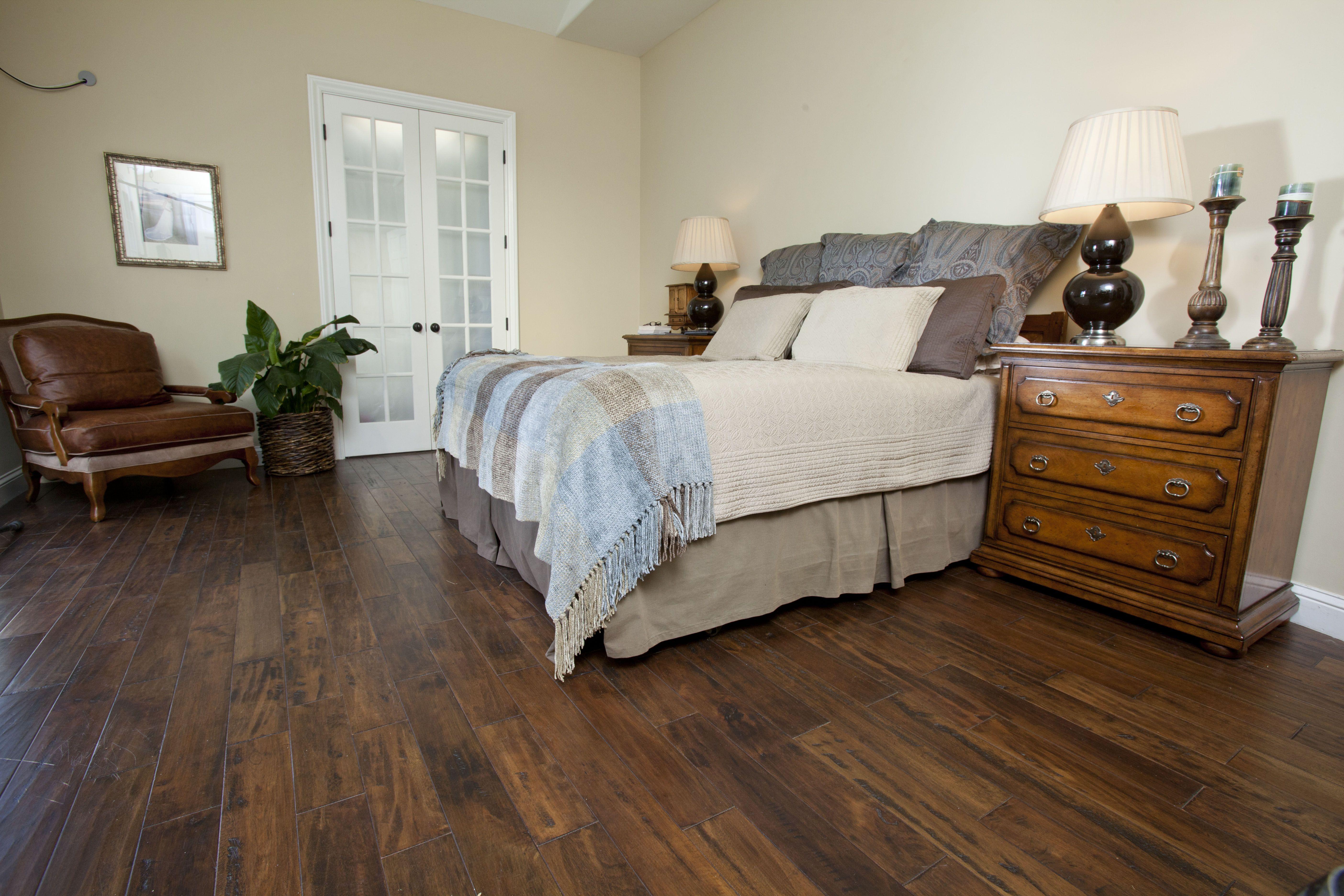 Hardwood is a nice compliment to this bedroom! Hardwood