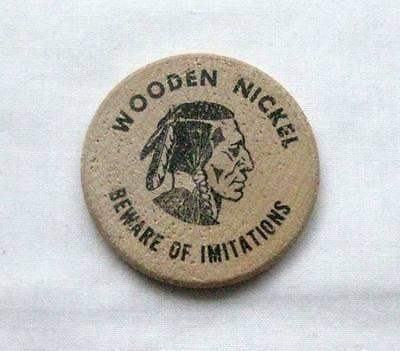A Vintage Indian Head Wooden Nickel That Is Advertising Fleetguard