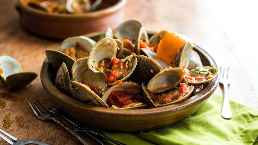 Steamed Clams in Spicy Tomato Sauce - Clams are high in Omega 3 fatty acids, low in calories, and very high in iron.