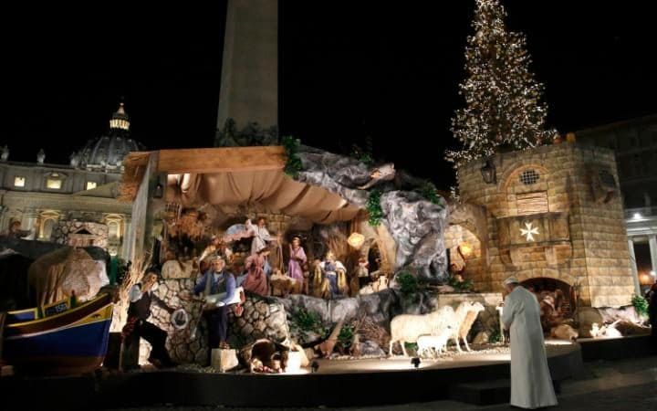 Pope Francis visits the traditional Crib in Saint Peter's Square at the Vatican on New Year's Eve