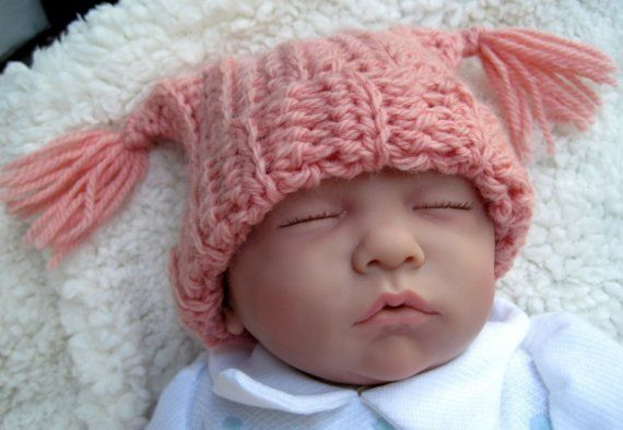 This adorable baby hat was made using a super soft lamb wool yarn in baby pink. This is a great baby hat for the cooler weather or for a