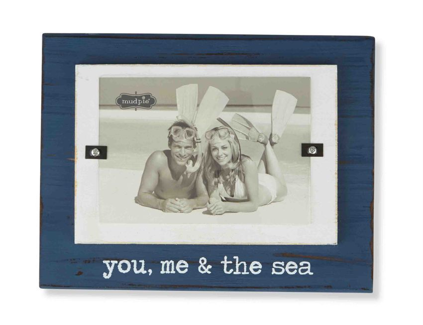 Chunky painted wood frame features painted 'you, me & the sea' sentiment.  Holds 3 1/2' x 5' photo.