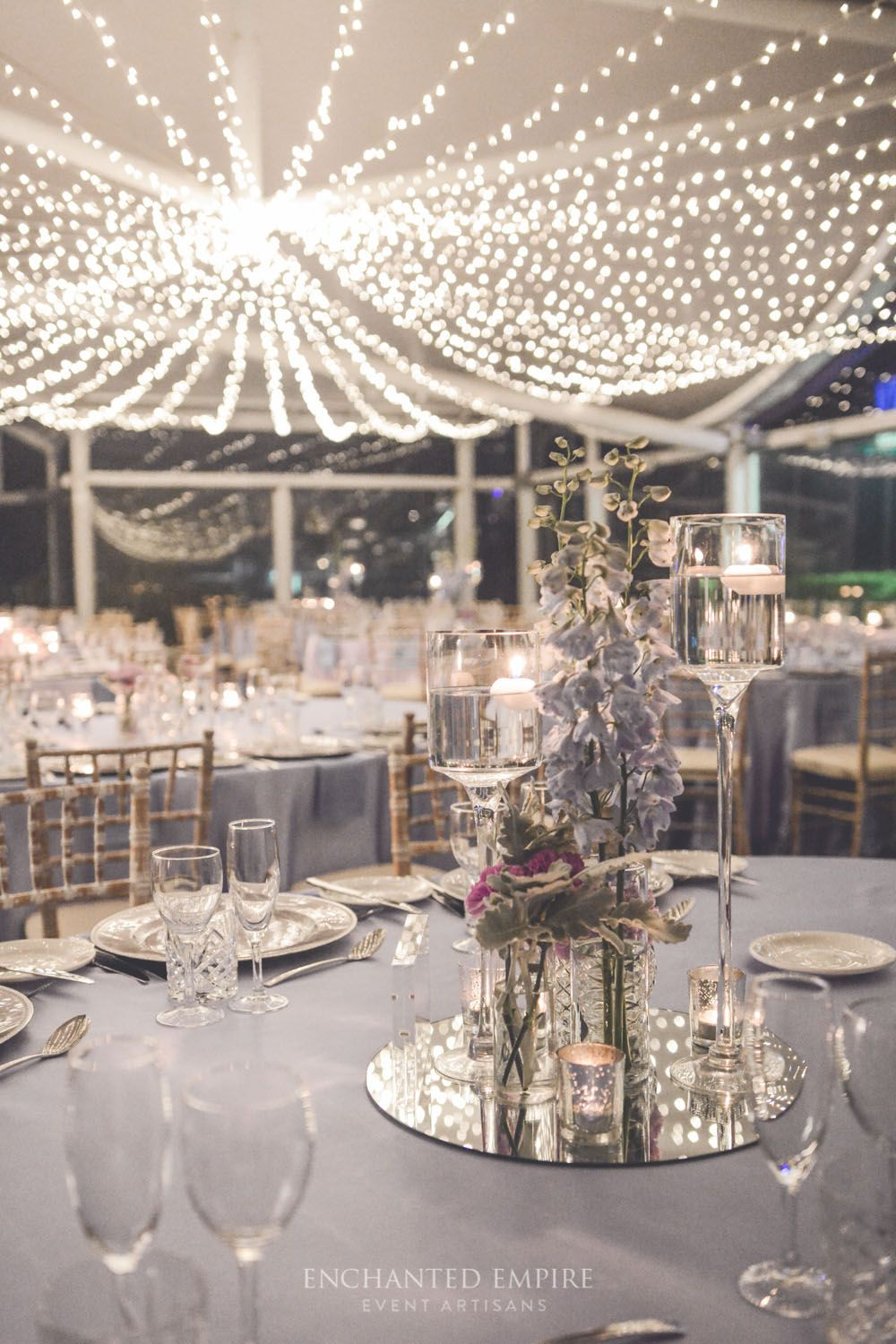 Light blue wedding decoration ideas  With a cascading Fairy Light Canopy this elegant pastel watercolour