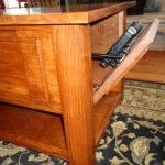 Coffee table with secret compartment for firearms or valuables