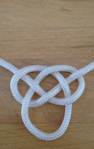 How To Tie The Double Celtic Knot Guidecentral Macrame