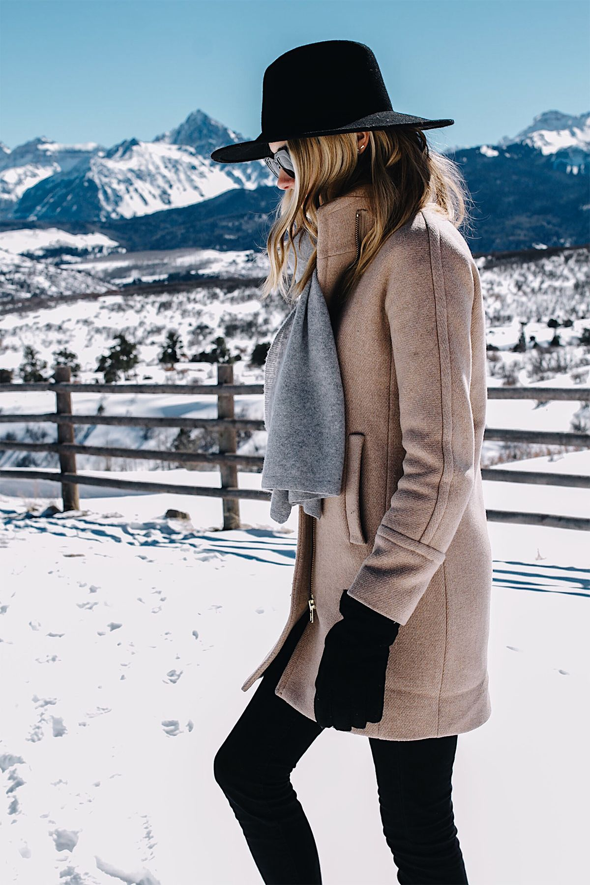 Telluride CO Snow Mountains Blonde Woman Wearing Grey Scarf Camel Coat Black Woo…