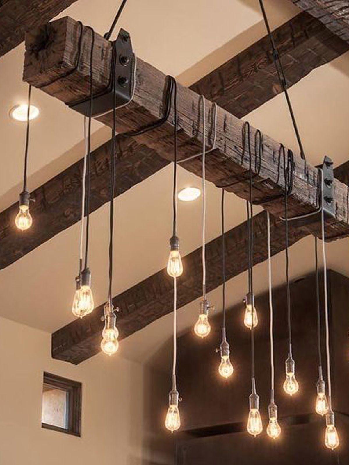 edison bulbs hung from a wood beam barn rustic