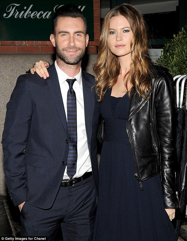 Pregnant behati prinsloo shows off her baby bump in semi sheer dress perfect pair it was reported in march that behati and her maroon 5 frontman husband were expecting a child junglespirit Images