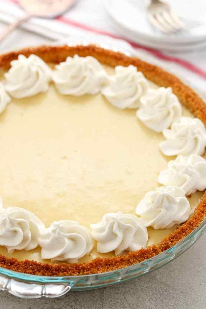 This easy Lemon Pie features a homemade graham cracker crust, a creamy lemon filling, and homemade whipped cream on top. The perfect dessert for lemon lovers! #homemadegrahamcrackercrust This easy Lemon Pie features a homemade graham cracker crust, a creamy lemon filling, and homemade whipped cream on top. The perfect dessert for lemon lovers! #homemadegrahamcrackercrust