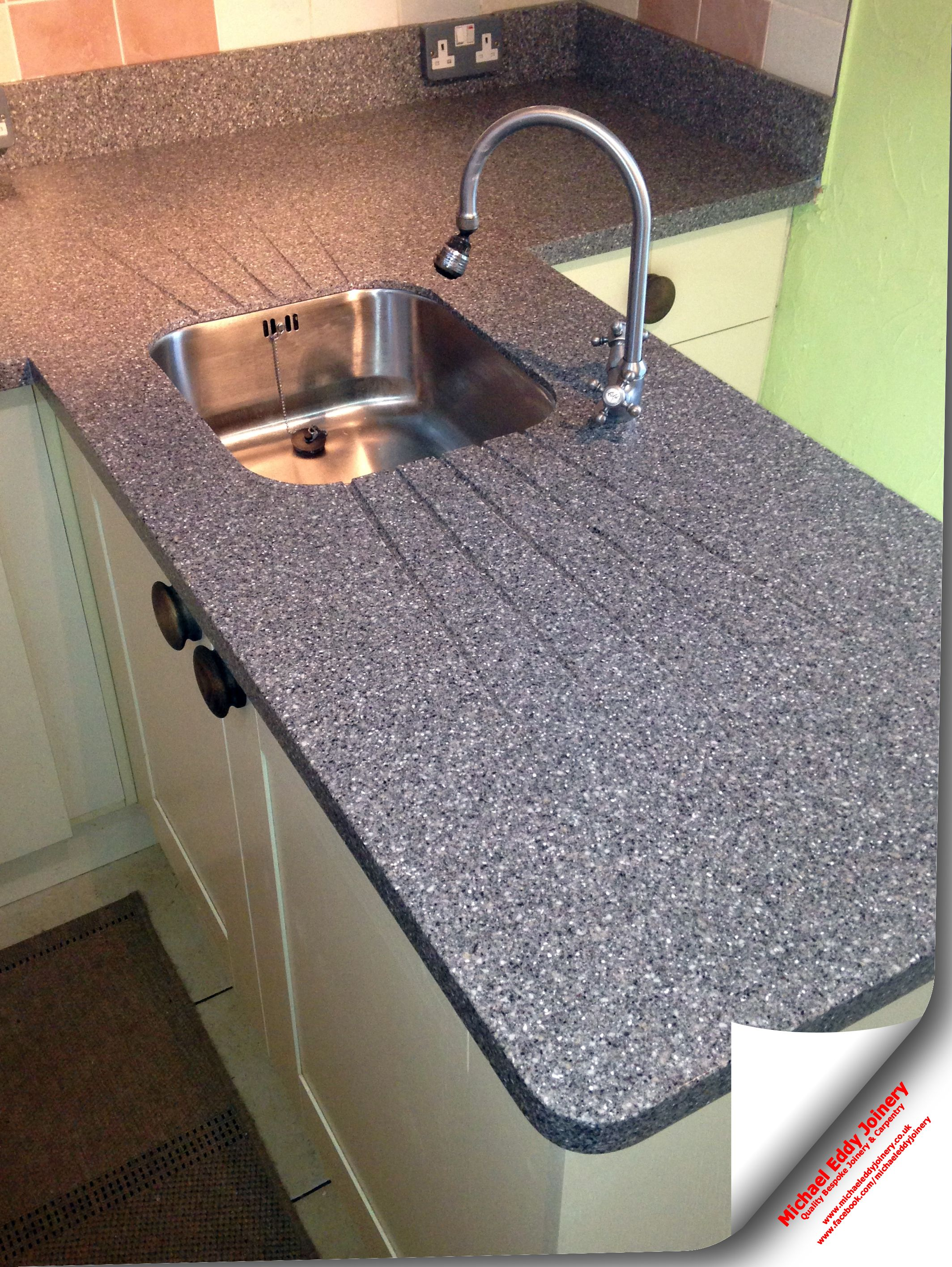 Gray Granite Worktops With Under Mounted Sink And Angled Drainer