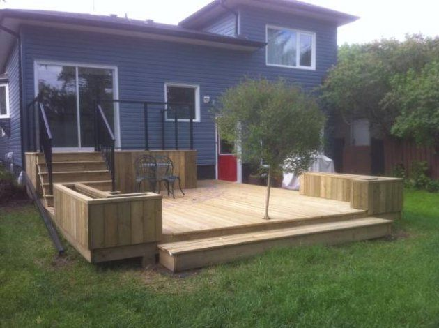 This Pressure Treated Wood Deck Features A Main Landing