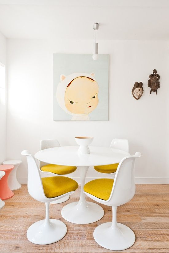 Tulip chairs add just the right amount of luxury to a minimalist interior.  . .
