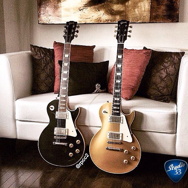Here's @rpcc2's Black Beauty and Gorgeous Gold Top. Which one would you grab first? #lespaul #choices #studio33guitar Learn to play guitar online at www.studio33guitarlessons.com