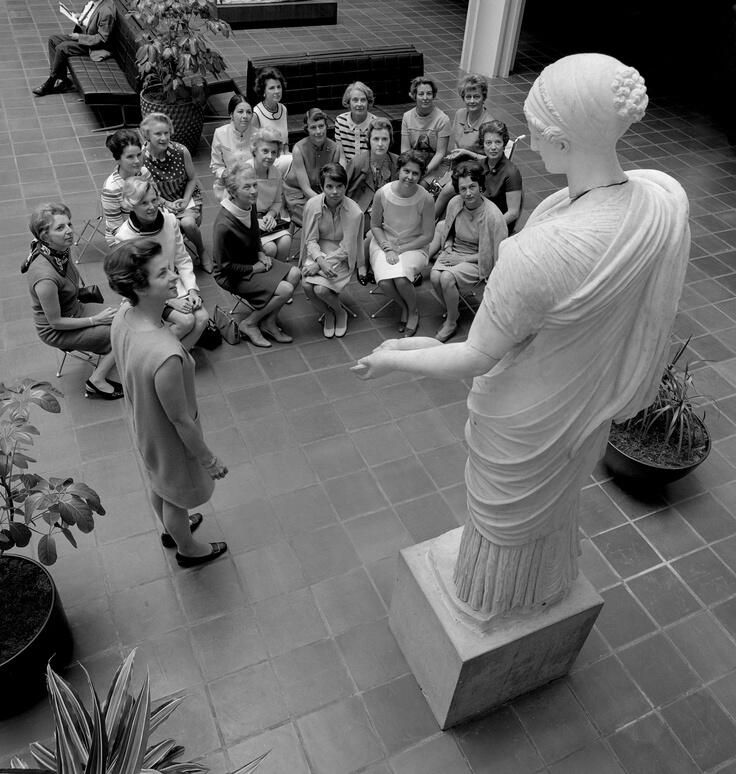 A docent giving a talk in the atrium in the Ahmanson building at LACMA, 1964.