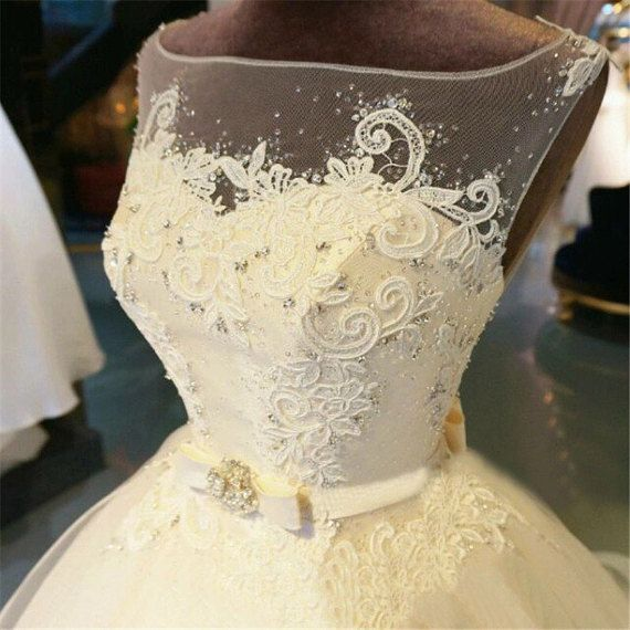 Wedding Dresses 2017 Lace Tulle Sweetheart  Specifics  Item Type Wedding Dresses For Pregnant Women Yes Sleeve Style Off the Shoulder Built-in Bra = Yes Actual Images = Yes Back Design = Lace Up Sleeve Length = Sleeveless Train = Chapel Train Wedding Dress Fabric Lace Decoration = Lace is_customized = Yes Neckline Sweetheart Dresses Length Floor-Length Tulle Robe de mariage Length Floor length Style Formal, Cheap, Elegant,Boho Color White, Ivory, Burgundy, Champagne Shipping = Fast Delivery…