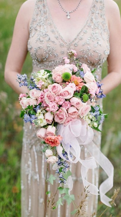 Wedding dress and bouquet idea; Featured Photographer: Morrissey Photography