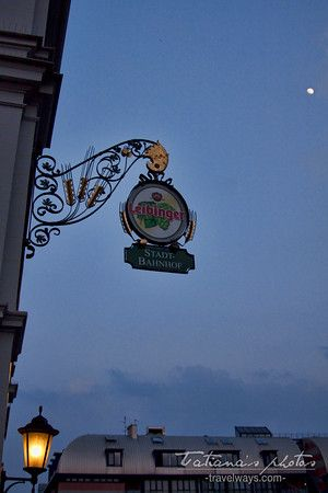 Leibinger beer sign at Stadt Bahnhof in Friedrichshafen, Germany at dusk